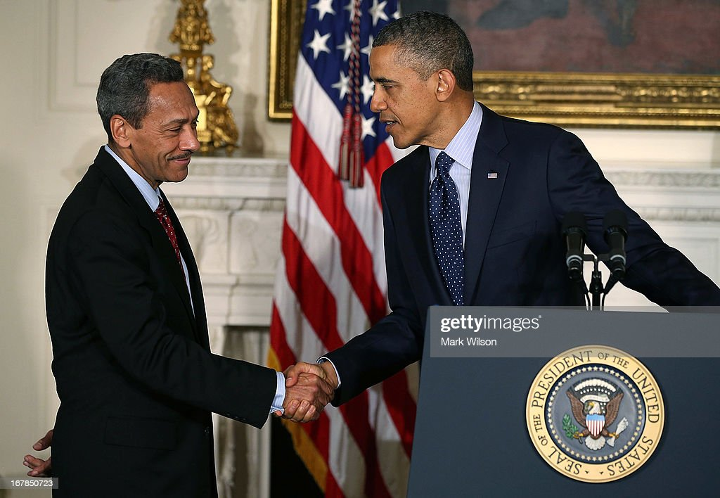 US President Barack Obama congratulates US Rep Mel Watt after nominating him to be the next director of the Federal Housing Finance Agency during a...