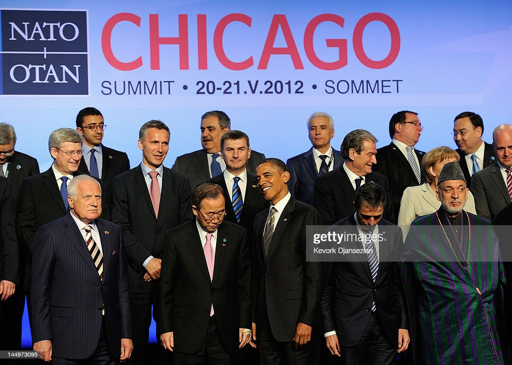 U.S. President Barack Obama (C), Czech Republic President Vaclav Klaus (L), UN Secretary General Ban Ki-moon (2ndL), NATO Secretary General Anders Fogh Rasmussen (2ndR), and Afghan President Hamid Karzai pose for the family photo after meeting on Afghanistan during the NATO Summit at McCormick Place on May 21, 2012 in Chicago, Illinois. As sixty heads of state converge for the two day summit that will address the situation in Afghanistan among other global defense issues, thousands of demonstrators have taken the streets to protest.