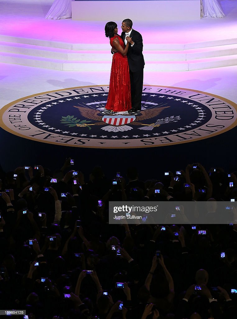 U.S. President Barack Obama (R) dances with first lady Michelle Obama at the Commander-in-Chief Ball on January 21, 2013 in Washington, DC. Pres. Obama was sworn-in for his second term as president during a public ceremonial inauguration earlier in the day.