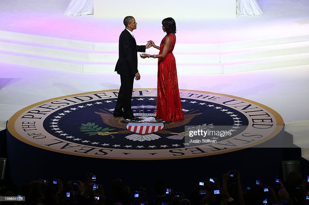 U.S. President Barack Obama (L) dances with first lady Michelle Obama at the Commander-in-Chief Ball on January 21, 2013 in Washington, DC. Pres. Obama was sworn-in for his second term as president during a public ceremonial inauguration earlier in the day.