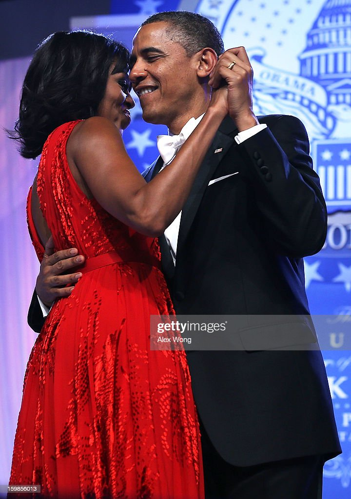 U.S. President Barack Obama dances with first lady Michelle Obama during the Inaugural Ball January 21, 2013 at Walter E. Washington Convention Center in Washington, DC. Obama was sworn in earlier in the day for a second term as president.