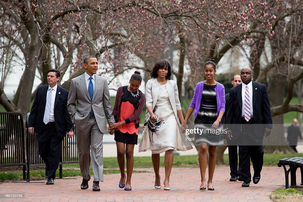 President <a gi-track='captionPersonalityLinkClicked' href=/galleries/search?phrase=Barack+Obama&family=editorial&specificpeople=203260 ng-click='$event.stopPropagation()'>Barack Obama</a>, daughter Sasha, first lady Michelle Obama and daughter Malia walk across Lafayette Park from the White House on their way to Easter services at St John's Episcopal Church March 31, 2013 in Washington, D.C.