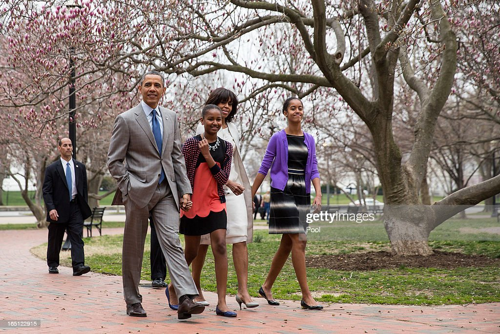 President Barack Obama, daughter Sasha, first lady Michelle Obama and daughter Malia walk across Lafayette Park from the White House on their way to Easter services at St John's Episcopal Church March 31, 2013 in Washington, D.C.
