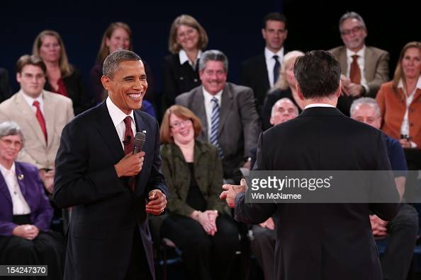 S President Barack Obama debates Republican presidential candidate Mitt Romney during a town hall style meeting at Hofstra University October 16 2012...