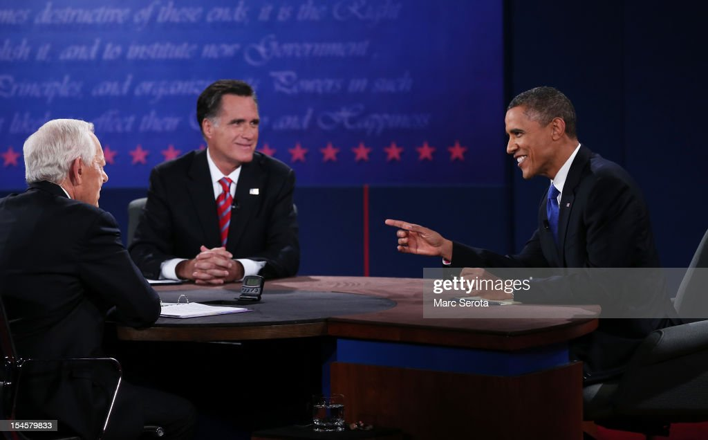 U.S. President Barack Obama (R) debates with Republican presidential candidate Mitt Romney as moderator Bob Schieffer (L) of CBS looks on at the Keith C. and Elaine Johnson Wold Performing Arts Center at Lynn University on October 22, 2012 in Boca Raton, Florida. The focus for the final presidential debate before Election Day on November 6 is foreign policy.