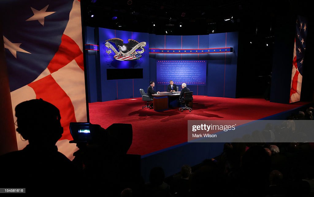 U.S. President Barack Obama (C) debates with Republican presidential candidate Mitt Romney (L) as moderator Bob Schieffer of CBS looks on at the Keith C. and Elaine Johnson Wold Performing Arts Center at Lynn University on October 22, 2012 in Boca Raton, Florida. The focus for the final presidential debate before Election Day on November 6 is foreign policy.