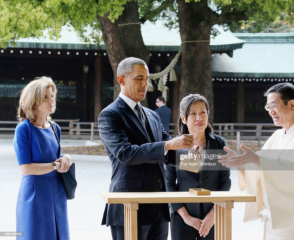 U.S. President <a gi-track='captionPersonalityLinkClicked' href=/galleries/search?phrase=Barack+Obama&family=editorial&specificpeople=203260 ng-click='$event.stopPropagation()'>Barack Obama</a> dedicates the 'Ema', wooden plaque at Meiji Jingu Shrine on April 24, 2014 in Tokyo, Japan. The U.S. President is on an Asian tour where he is due to visit Japan, South Korea, Malaysia and Philippines.