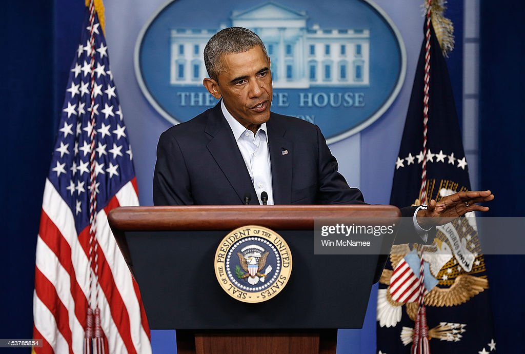 U.S. President <a gi-track='captionPersonalityLinkClicked' href=/galleries/search?phrase=Barack+Obama&family=editorial&specificpeople=203260 ng-click='$event.stopPropagation()'>Barack Obama</a> delivers a statement in the Brady Press Briefing Room of the White House on August 18, 2014 in Washington, DC. Obama returned early from his vacation in Martha's Vineyard to hold meetings with his national security team and also with U.S. Attorney General Eric Holder in regards to the situation in Iraq and the continuing violence in Ferguson, Missouri.