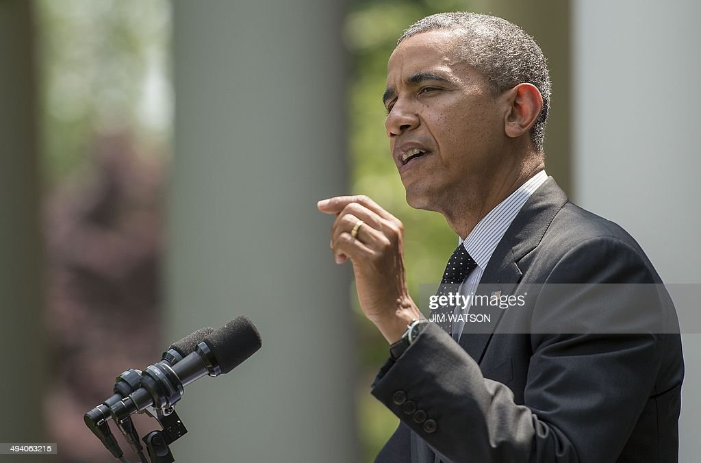 US President <a gi-track='captionPersonalityLinkClicked' href=/galleries/search?phrase=Barack+Obama&family=editorial&specificpeople=203260 ng-click='$event.stopPropagation()'>Barack Obama</a> delivers a statement on American troops in Afghanistan from the Rose Garden at the White House in Washington, DC, May 27, 2014. Obama said Tuesday that plans to keep 9,800 US troops in Afghanistan next year depended on the Kabul government signing a long-delayed agreement. Obama, confirming plans for a full withdrawal by the end of 2016, said he was 'hopeful' as both candidates to be Afghanistan's next president support the accord. AFP PHOTO / Jim WATSON