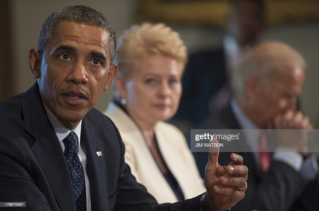 US President Barack Obama delivers a statement on Syria during a meeting with Lithuania's President Dalia Grybauskaite (C) and Vice President Joe Biden (R) at the White House in Washington, DC on August 30, 2013. AFP PHOTO/Jim WATSON