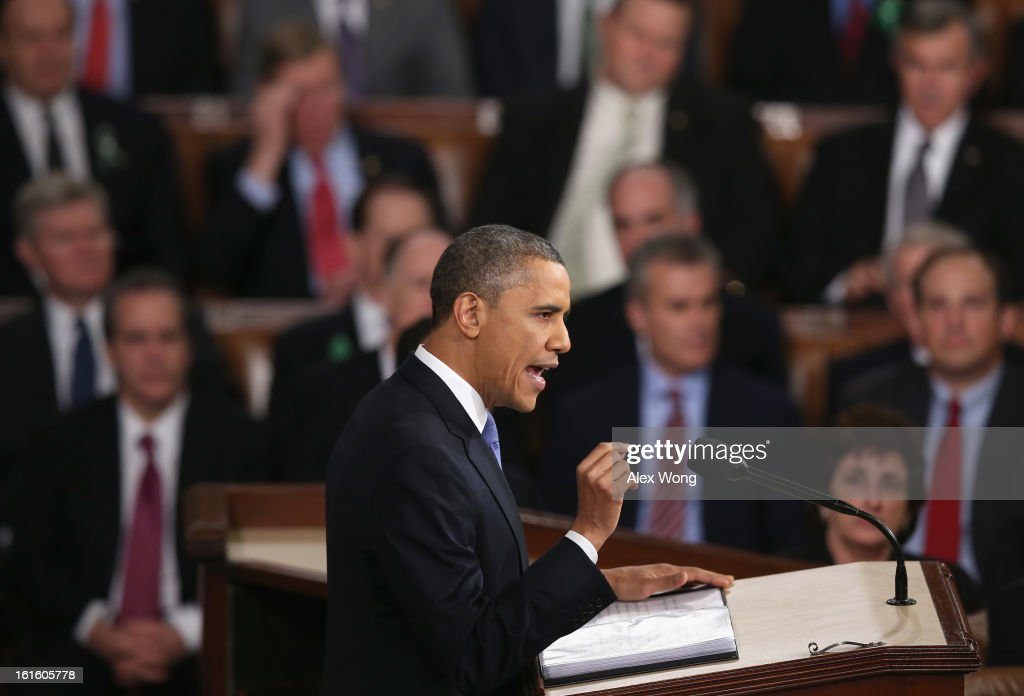 U.S. President <a gi-track='captionPersonalityLinkClicked' href=/galleries/search?phrase=Barack+Obama&family=editorial&specificpeople=203260 ng-click='$event.stopPropagation()'>Barack Obama</a> delivers his State of the Union speech before a joint session of Congress at the U.S. Capitol February 12, 2013 in Washington, DC. Facing a divided Congress, Obama focused his speech on new initiatives designed to stimulate the U.S. economy and said, 'It's not a bigger government we need, but a smarter government that sets priorities and invests in broad-based growth'.