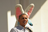 President Barack Obama delivers opening remarks from the Truman Balcony as a person dressed as the Easter Bunny stands behind him during the White...