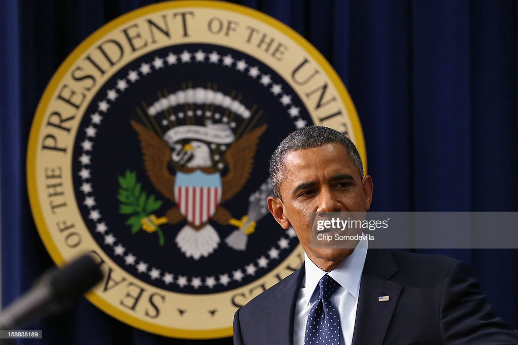 U.S. President <a gi-track='captionPersonalityLinkClicked' href=/galleries/search?phrase=Barack+Obama&family=editorial&specificpeople=203260 ng-click='$event.stopPropagation()'>Barack Obama</a> delivers remarks about the fiscal cliff negotiations in the Eisenhower Executive Office Building next to the White House December 31, 2012 in Washington, DC. Obama said he was hopeful that an agreement could be found to avert the fiscal cliff in Congress, which is closing in on a deal that would raise taxes on households that make more than $450,000 a year and individuals who make more than $400,000.