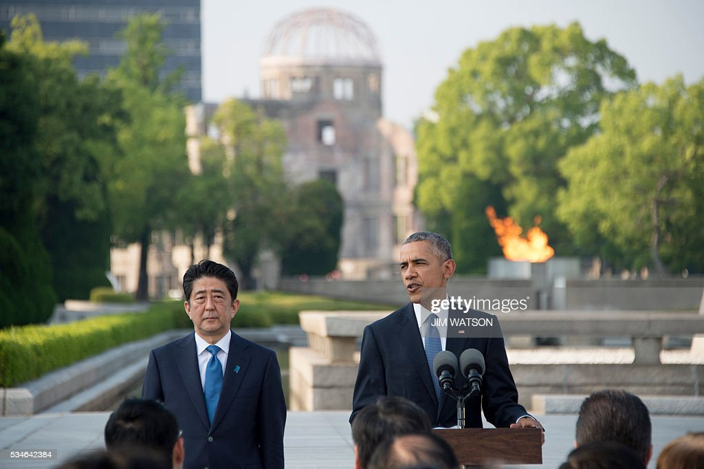 US President Barack Obama delivers remarks after laying a wreath at the Hiroshima Peace Memorial Park as Japan's Prime Minister Shinzo Abe (L) looks on, in Hiroshima on May 27, 2016. Obama on May 27 paid moving tribute to victims of the world's first nuclear attack. WATSON