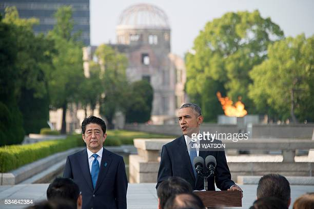 US President Barack Obama delivers remarks after laying a wreath at the Hiroshima Peace Memorial Park as Japan's Prime Minister Shinzo Abe looks on...