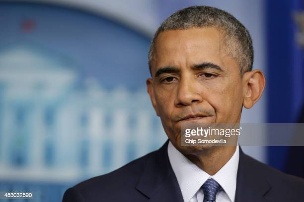 S President Barack Obama delivers remarks and takes reporters' questions in the Brady Press Briefing Room at the White House August 1 2014 in...