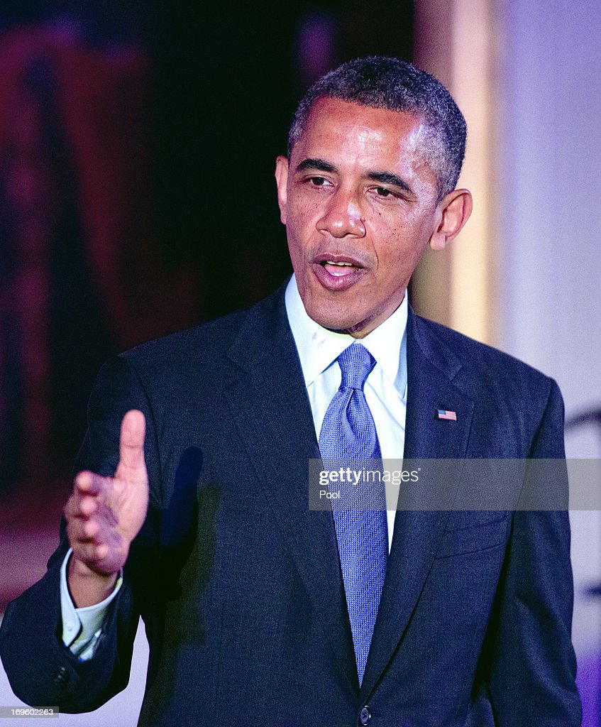 U.S. President <a gi-track='captionPersonalityLinkClicked' href=/galleries/search?phrase=Barack+Obama&family=editorial&specificpeople=203260 ng-click='$event.stopPropagation()'>Barack Obama</a> delivers remarks at the Asian American and Pacific Islander (AAPI) Heritage Month Celebration in the East Room of the White House May 28, 2013 in Washington, D.C. Obama called again for immigration reform during his speech.