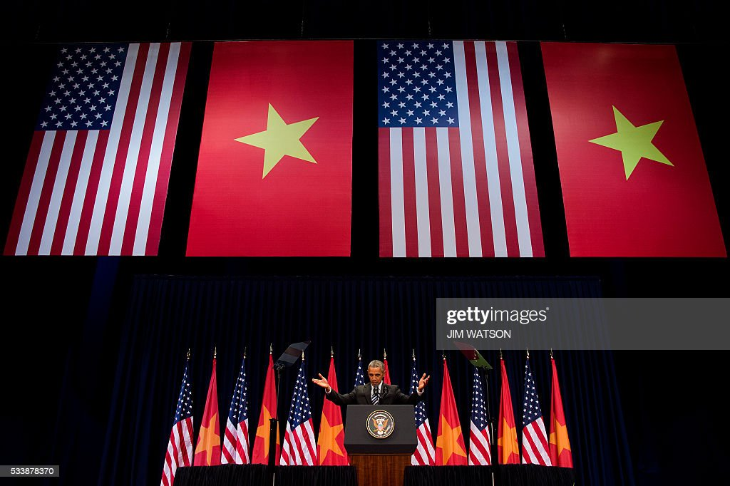 US President Barack Obama delivers remarks at the National Convention Center in Hanoi on May 24, 2016. Obama, currently on a visit to Vietnam, met with civil society leaders including some of the country's long-harassed critics on May 24. The visit is Obama's first to the country -- and the third by a sitting president since the end of the Vietnam War in 1975. / AFP / JIM