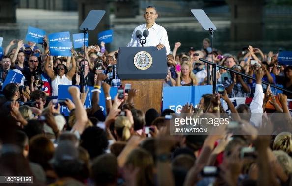 US President Barack Obama delivers remarks at Waterloo Center for the Arts in Waterloo Iowa August 14 2012 during his threeday campaign bus tour...