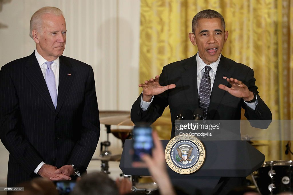 President Barack Obama (R) delivers remarks during a reception to mark the Cinco de Mayo holiday with Vice President Joe Biden in the East Room at the White House May 5, 2016 in Washington, DC. The holiday commemorates the Mexican Army's unlikely victory over French forces at the Battle of Puebla in on May 5, 1862.