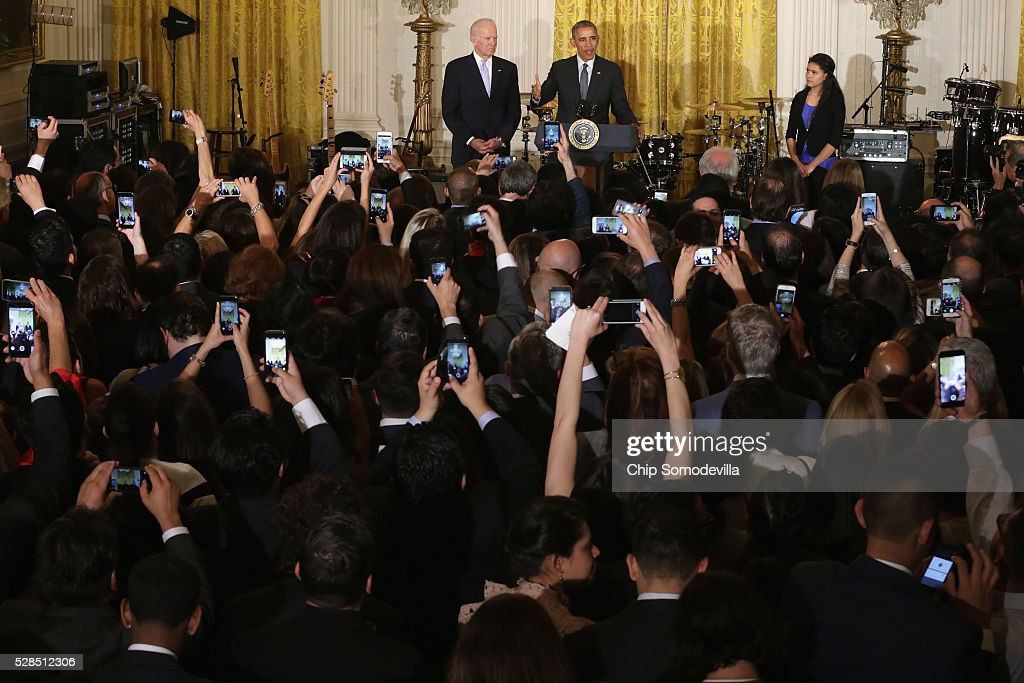 President Barack Obama (C) delivers remarks during a reception to mark the Cinco de Mayo holiday with Vice President Joe Biden and Yanely Gonzalez (R) in the East Room at the White House May 5, 2016 in Washington, DC. Gonzalez's parents are undocumented immigrants from Mexico and she is a U.S. citizen who will vote in her first presidential election this year. The holiday commemorates the Mexican Army's unlikely victory over French forces at the Battle of Puebla in on May 5, 1862.