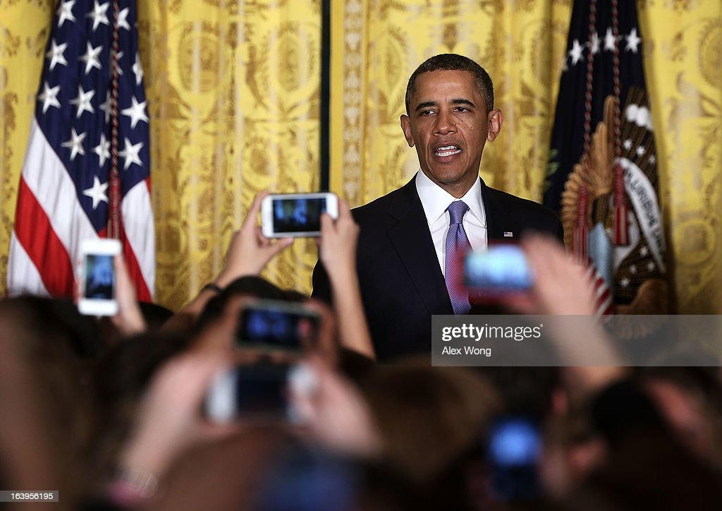 U.S. President <a gi-track='captionPersonalityLinkClicked' href=/galleries/search?phrase=Barack+Obama&family=editorial&specificpeople=203260 ng-click='$event.stopPropagation()'>Barack Obama</a> delivers remarks during a Women's History Month Reception in the East Room of the White House March 18, 2013 in Washington, DC. President Obama was accompanied by first lady Michelle Obama to participate in the event.
