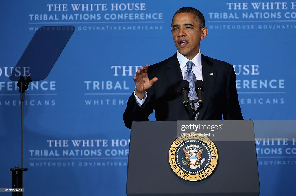 U.S. President <a gi-track='captionPersonalityLinkClicked' href=/galleries/search?phrase=Barack+Obama&family=editorial&specificpeople=203260 ng-click='$event.stopPropagation()'>Barack Obama</a> delivers remarks during the closing session of the White House Tribal Nations Conference at the Department of Interior December 5, 2012 in Washington, DC. Obama and cabinet secretaries from his administration addressed the conference, which included breakout sessions on topics like 'Protecting Our Communities: Law Enforcement and Disaster Relief,' 'Building Healthy Communities, Excellence in Education and Native American Youth,' and other subjects.
