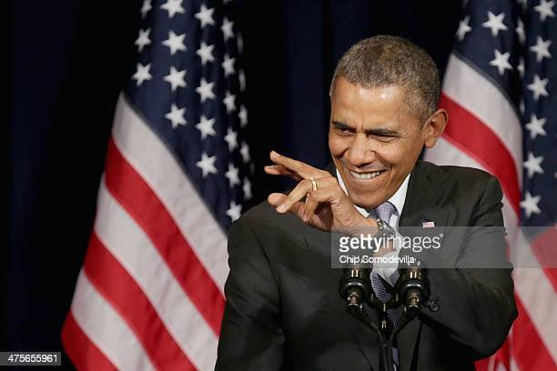 S President Barack Obama delivers remarks during the Democratic National Committee's Winter Meeting at the Capitol Hilton February 28 2014 in...