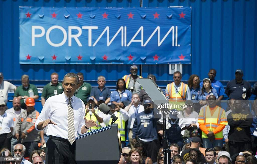 US President Barack Obama delivers remarks from the wharf near the PortMiami tunnel project in Miami, Florida on March 29, 2013. AFP PHOTO/Jim WATSON