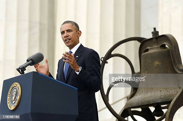President Barack Obama delivers remarks in front of a freedom bell during the 'Let Freedom Ring' commemoration event August 28 2013 in Washington DC...