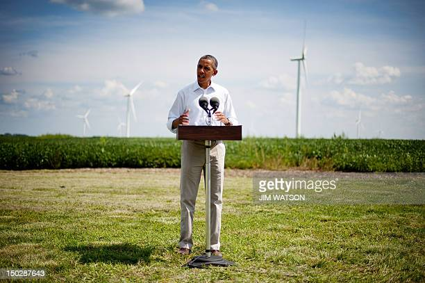 US President Barack Obama delivers remarks on wind power at the Heil Family Farm in Haverhill Iowa on August 14 2012 during his threeday campaign bus...