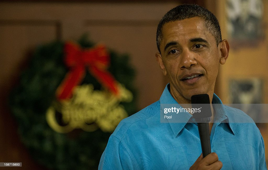 US President <a gi-track='captionPersonalityLinkClicked' href=/galleries/search?phrase=Barack+Obama&family=editorial&specificpeople=203260 ng-click='$event.stopPropagation()'>Barack Obama</a> delivers remarks while visiting military personnel eating Christmas Dinner at Anderson Hall at Marine Corps Base Hawaii on December 25, 2012 in Kaneohe Bay, Hawaii. The president and his family spend the Christmas holiday in Hawaii, Obama's birthplace.