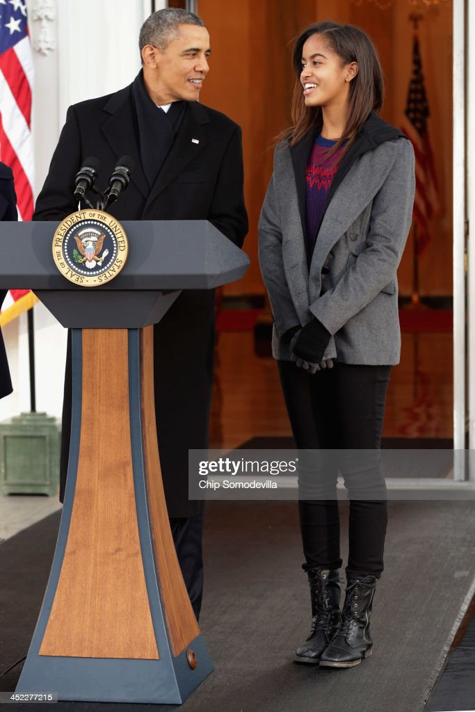 U.S. President <a gi-track='captionPersonalityLinkClicked' href=/galleries/search?phrase=Barack+Obama&family=editorial&specificpeople=203260 ng-click='$event.stopPropagation()'>Barack Obama</a> delivers remarks with his daughter <a gi-track='captionPersonalityLinkClicked' href=/galleries/search?phrase=Malia+Obama&family=editorial&specificpeople=2631620 ng-click='$event.stopPropagation()'>Malia Obama</a>, 15, before pardoning the 2013 National Thanksgiving Turkey, 'Popcorn' on the North Portico of the White House November 27, 2013 in Washington, DC. A 38-pound, full-grown Broad Breasted White domesticated turkey, 'Popcorn' and its alternate 'Caramel' will be sent to live at Mount Vernon, the estate and home of George Washington.