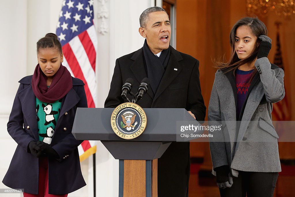 U.S. President <a gi-track='captionPersonalityLinkClicked' href=/galleries/search?phrase=Barack+Obama&family=editorial&specificpeople=203260 ng-click='$event.stopPropagation()'>Barack Obama</a> delivers remarks with his daughters <a gi-track='captionPersonalityLinkClicked' href=/galleries/search?phrase=Malia+Obama&family=editorial&specificpeople=2631620 ng-click='$event.stopPropagation()'>Malia Obama</a> (R), 15, and <a gi-track='captionPersonalityLinkClicked' href=/galleries/search?phrase=Sasha+Obama&family=editorial&specificpeople=2631619 ng-click='$event.stopPropagation()'>Sasha Obama</a>, 12, before pardoning the 2013 National Thanksgiving Turkey, 'Popcorn' on the North Portico of the White House November 27, 2013 in Washington, DC. A 38-pound, full-grown Broad Breasted White domesticated turkey, 'Popcorn' and its alternate 'Caramel' will be sent to live at Mount Vernon, the estate and home of George Washington.