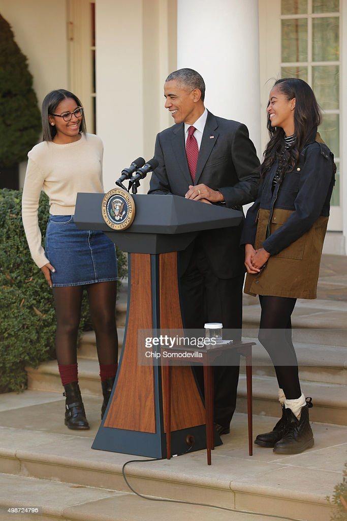 U.S. President Barack Obama delivers remarks with his daughters Sasha (L) and Malia during the annual turkey pardoning ceremony in the Rose Garden at the White House November 25, 2015 in Washington, DC. In a tradition dating back to 1947, the president pardons a turkey, sparing the tom -- and his alternate -- from becoming a Thanksgiving Day feast. This year, Americans were asked to choose which of two turkeys would be pardoned and to cast their votes on Twitter.