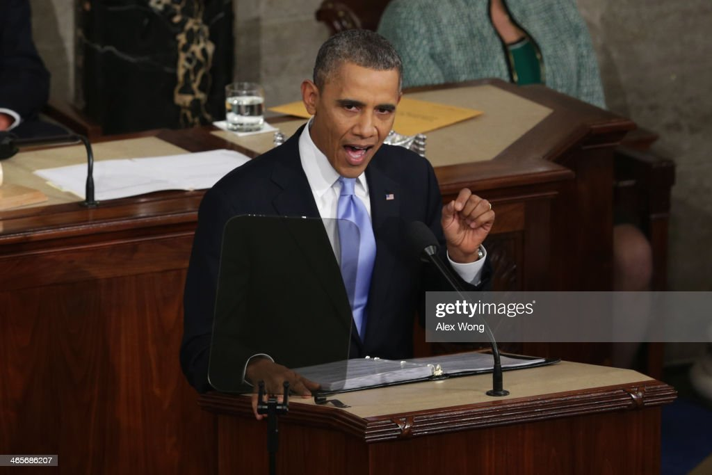 U.S. President <a gi-track='captionPersonalityLinkClicked' href=/galleries/search?phrase=Barack+Obama&family=editorial&specificpeople=203260 ng-click='$event.stopPropagation()'>Barack Obama</a> delivers the State of the Union address to a joint session of Congress in the House Chamber at the U.S. Capitol on January 28, 2014 in Washington, DC. In his fifth State of the Union address, Obama is expected to emphasize on healthcare, economic fairness and new initiatives designed to stimulate the U.S. economy with bipartisan cooperation.