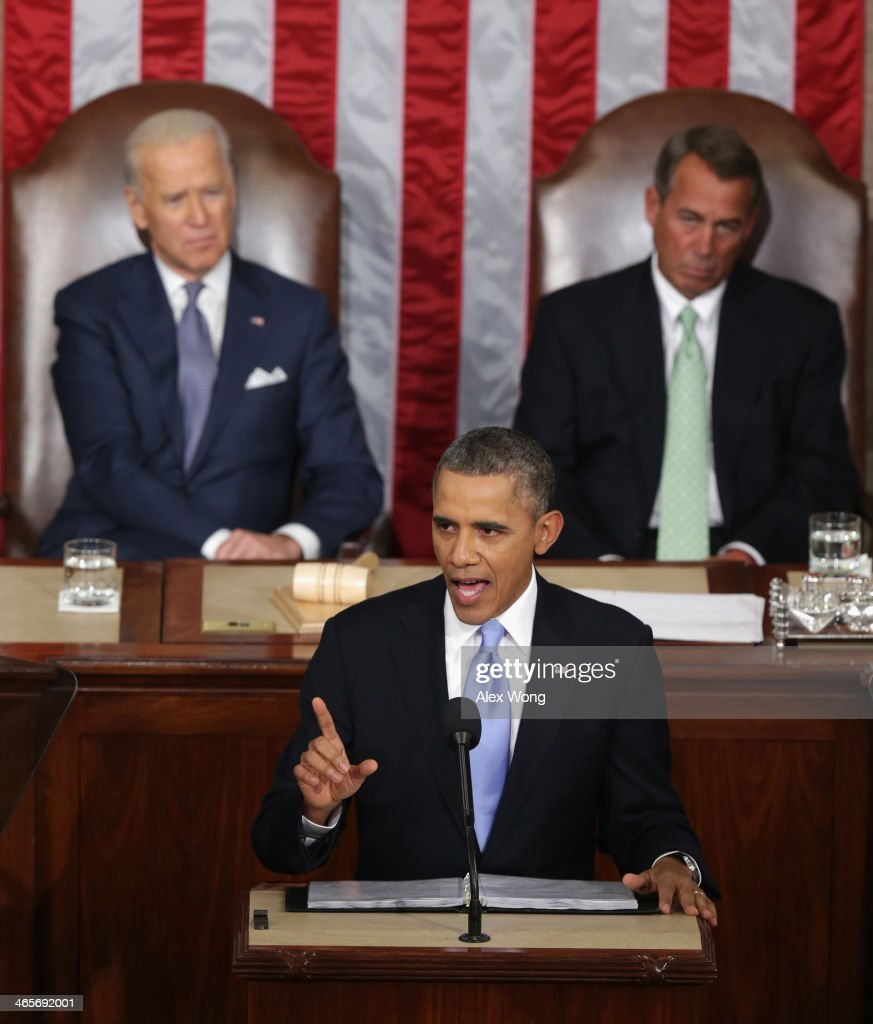 U.S. President <a gi-track='captionPersonalityLinkClicked' href=/galleries/search?phrase=Barack+Obama&family=editorial&specificpeople=203260 ng-click='$event.stopPropagation()'>Barack Obama</a> delivers the State of the Union address to a joint session of Congress as U.S. Vice President Joe Biden (L) and Speaker of the House U.S. Rep. <a gi-track='captionPersonalityLinkClicked' href=/galleries/search?phrase=John+Boehner&family=editorial&specificpeople=274752 ng-click='$event.stopPropagation()'>John Boehner</a> (R-OH) listen in the House Chamber at the U.S. Capitol on January 28, 2014 in Washington, DC. In his fifth State of the Union address, Obama is expected to emphasize on healthcare, economic fairness and new initiatives designed to stimulate the U.S. economy with bipartisan cooperation.