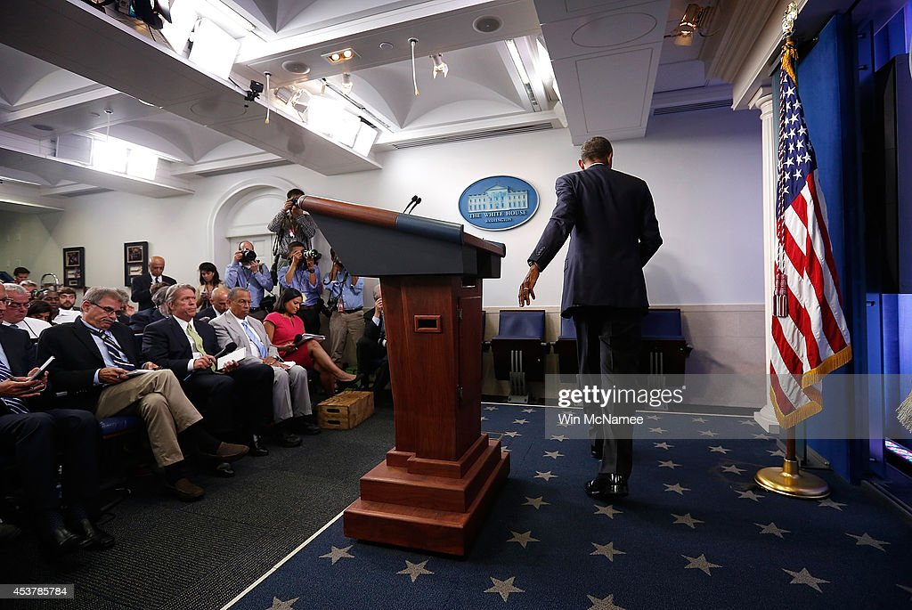 U.S. President <a gi-track='captionPersonalityLinkClicked' href=/galleries/search?phrase=Barack+Obama&family=editorial&specificpeople=203260 ng-click='$event.stopPropagation()'>Barack Obama</a> departs after delivering a statement and answering questions at a press conference in the Brady Press Briefing Room of the White House on August 18, 2014 in Washington, DC. Obama returned early from his vacation in Martha's Vineyard to hold meetings with his national security team and also with U.S. Attorney General Eric Holder in regards to the situation in Iraq and the continuing violence in Ferguson, Missouri.