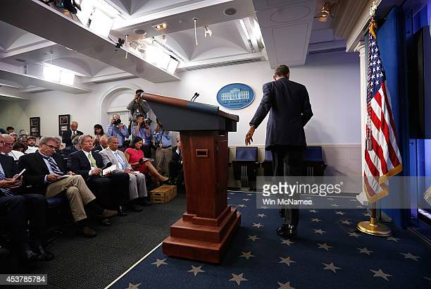 S President Barack Obama departs after delivering a statement and answering questions at a press conference in the Brady Press Briefing Room of the...