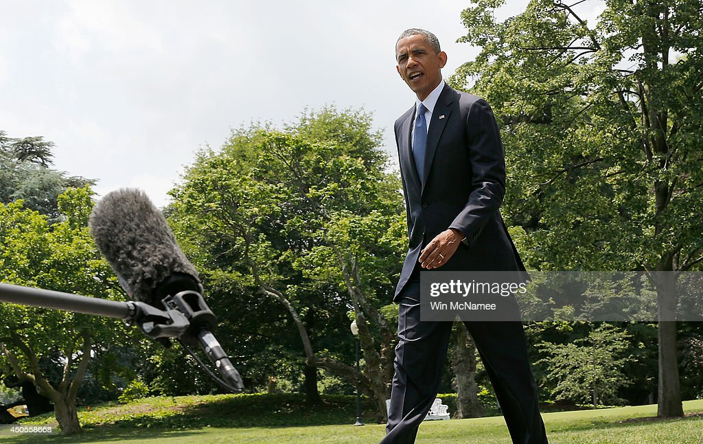 U.S. President <a gi-track='captionPersonalityLinkClicked' href=/galleries/search?phrase=Barack+Obama&family=editorial&specificpeople=203260 ng-click='$event.stopPropagation()'>Barack Obama</a> departs after making s a statement on the situation in Iraq June 13, 2014 on the south lawn of the White House in Washington, DC. Obama said he will make a decision in the 'days ahead' about the use of American military power to aid the Iraqi government in its battle against Islamic insurgents.