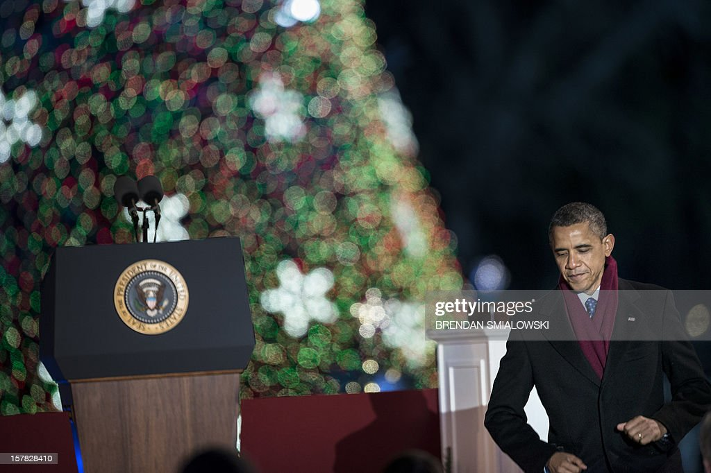 US President Barack Obama departs after speaking during the 90th annual National Christmas Tree Lighting on the Ellipse of the National Mall December 6, 2012 in Washington, DC. Obama and others attended the event which included entertainment before the lighting of the National Christmas Tree. AFP PHOTO/Brendan SMIALOWSKI