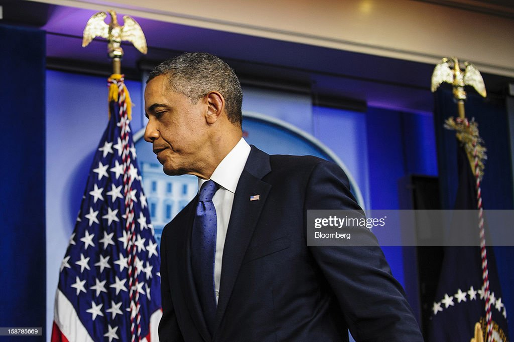 U.S. President Barack Obama departs after speaking in the Brady Press Briefing Room at the White House in Washington, D.C., U.S., on Friday, Dec. 28, 2012. Obama said he's 'modestly optimistic' Congress can pass a bill to avert more than $600 billion in tax increases and spending cuts set to start Jan. 1. Photographer: Pete Marovich/Bloomberg via Getty Images