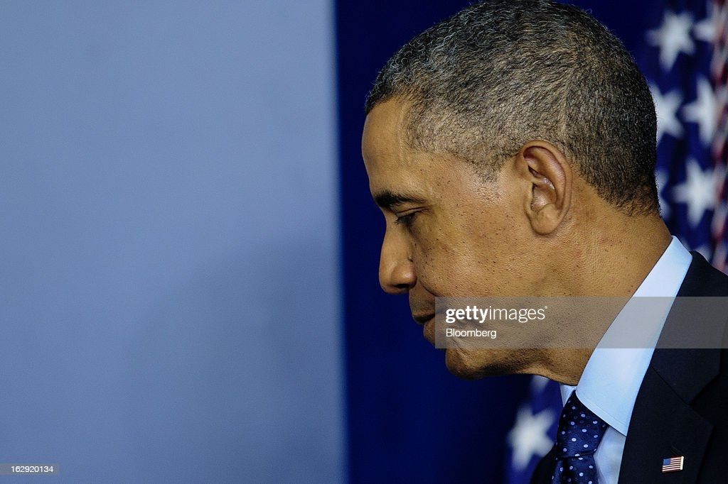 "U.S. President Barack Obama departs after speaking to the media in the Brady Press Briefing Room at the White House in Washington, D.C., U.S., on Friday, March 1, 2013. Obama said the automatic spending cuts set to kick in today will be a ""slow grind"" on the economy and that it may take weeks to win over enough lawmakers from both parties to reach a deal on a replacement deficit-cutting plan. Photographer: Pete Marovich/Bloomberg via Getty Images"