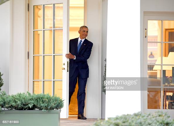 President Barack Obama departs the Oval Office for the last time as president at the White House in Washington DC January 20 2017 / AFP / JIM WATSON