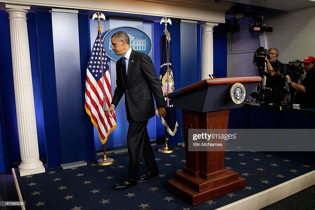 U.S. President <a gi-track='captionPersonalityLinkClicked' href=/galleries/search?phrase=Barack+Obama&family=editorial&specificpeople=203260 ng-click='$event.stopPropagation()'>Barack Obama</a> departs the White House Briefing Room after making a statement on the capture of Dzhokhar A. Tsarnaev on April 19, 2013 in Washington, DC. A manhunt for a suspect in the Boston Marathon bombing, Dzhokhar A. Tsarnaev, 19, ended this evening with his capture on a boat parked on a residential property in Watertown, Massachusetts. His brother Tamerlan Tsarnaev, 26, the other suspect, was shot and killed by police early this morning after a car chase and shootout with police. The two men are suspects in the bombings at the Boston Marathon on April 15 that killed three people and wounded at least 170.