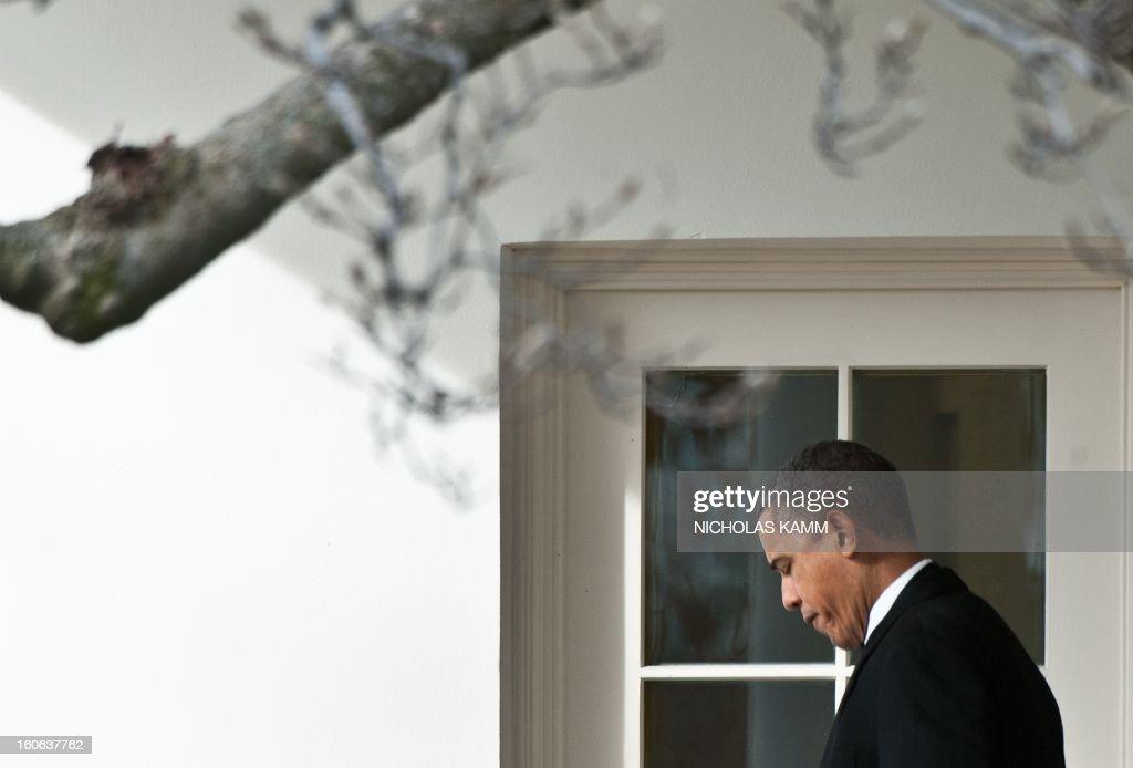 US President Barack Obama departs the White House in Washington,DC on February 4, 2013. Obama travels to Minneapolis to tout his gun control proposals. AFP PHOTO/Nicholas KAMM