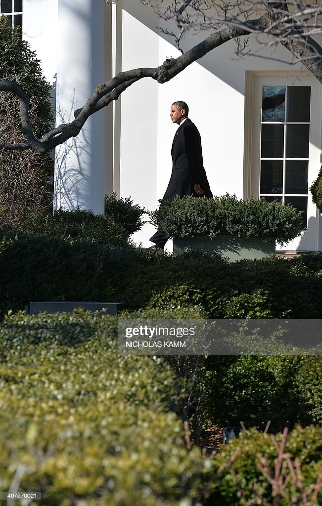 US President Barack Obama departs the White House in WashingtonDC on February 7 2014 for Lansing Michigan where he will speak at the Michigan...