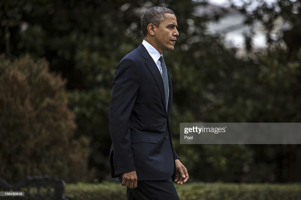U.S. President <a gi-track='captionPersonalityLinkClicked' href=/galleries/search?phrase=Barack+Obama&family=editorial&specificpeople=203260 ng-click='$event.stopPropagation()'>Barack Obama</a> departs the White House to travel to Connecticut December 16, 2012 in Washington, DC. President Obama will meet with the families of victims of the shooting at Sandy Hook Elementary School in Newtown.