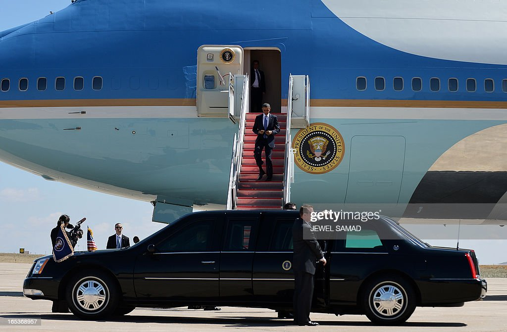 US President Barack Obama disembarks from Air Force One at the Buckley Air Force Base in Denver, Colorado, on April 3, 2013 where he will continue asking the American people to join him in calling on Congress to pass common-sense measures to reduce gun violence. The president has demanded votes on measures including a requirement for background checks on all gun purchases, limits on high capacity ammunition magazines, a reinstated assault weapons ban, new gun trafficking laws, and new school safety plans. But the assault weapons ban push appears certain to fail to get sufficient support in the Senate, following a huge campaign by the gun lobby and opposition from Republicans and Democrats from conservative and rural areas. AFP PHOTO/Jewel Samad