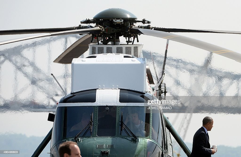 US President Barack Obama disembarks from Marien One helicopter as he arrives in Tarrytown, New York, on May 14, 2014 to speak on the need for a '21st Century Transportation Infrastructure.' AFP PHOTO/Jewel Samad